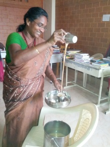 Rosemary pouring tea in the staff room.