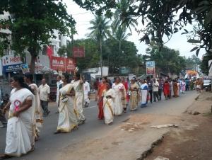 Ladies wearing Kerala saries.