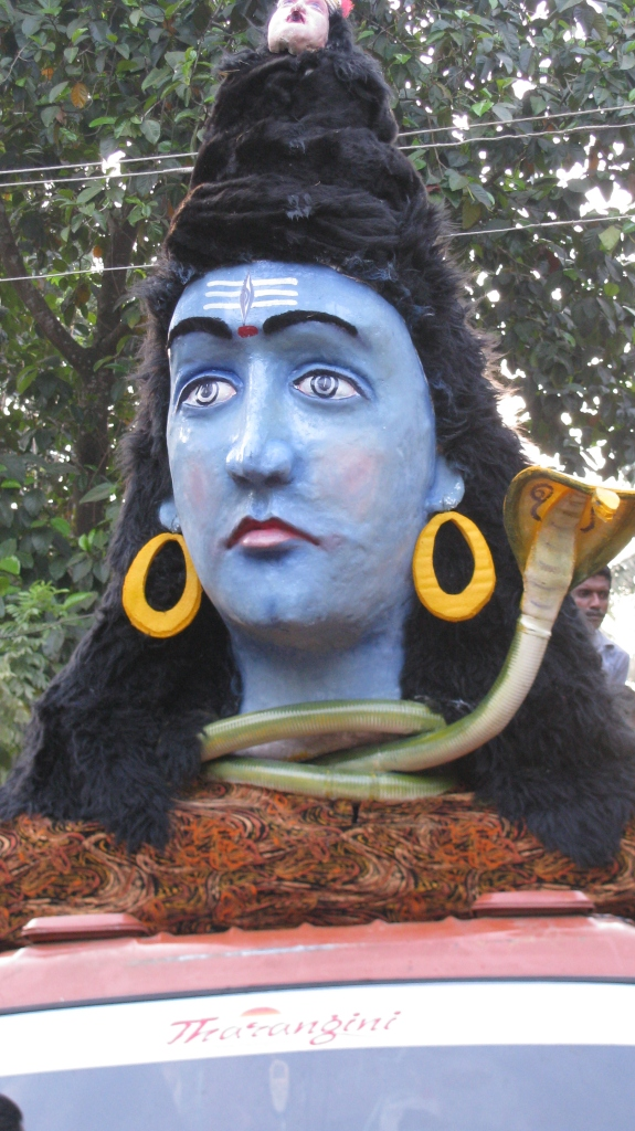 The God Shiva, heading the parade after being bathed in the river.