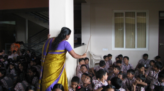 Photograph taken with permission - Taming the waiting children on Sport's Day