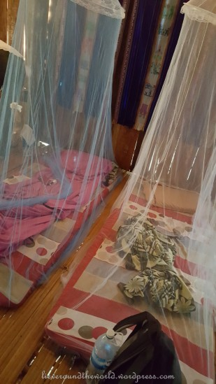 Thin mattresses on a bamboo floor, plus a mosquito net